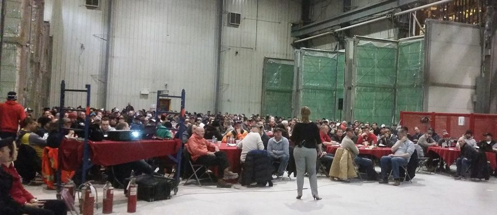 Amber Hiuser speaks to a group of 450 employees