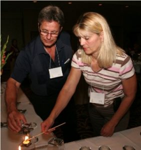 Mom and dad light candle on table