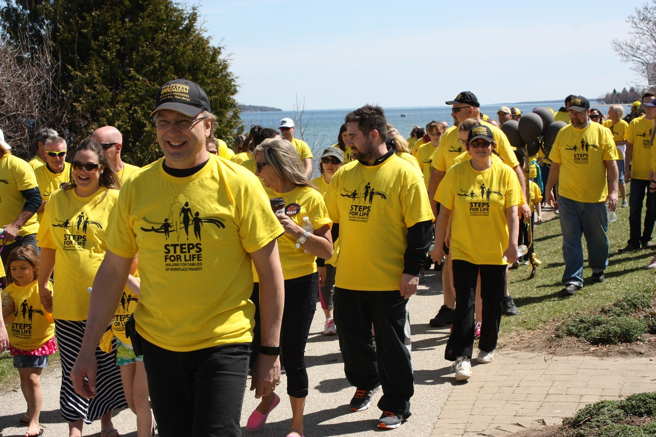 Walkers in yellow T-shirts