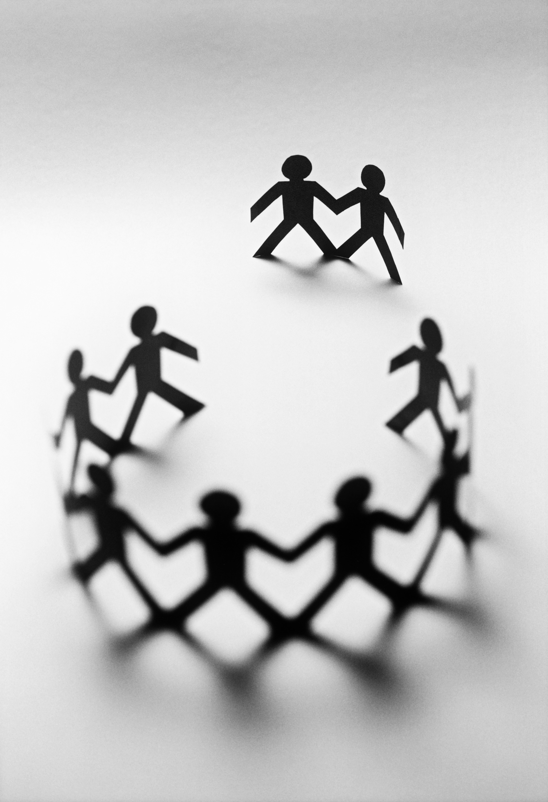 Paper cut outs of people in a circle