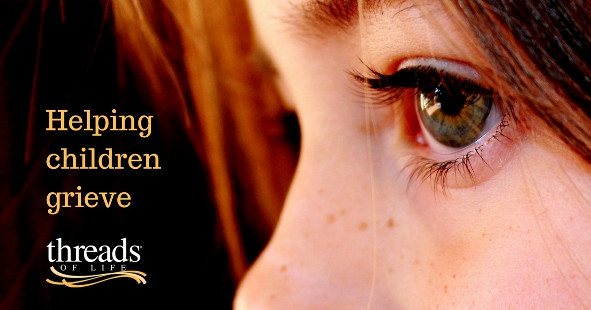 Close up of young girl's face with text reading helping children grieve