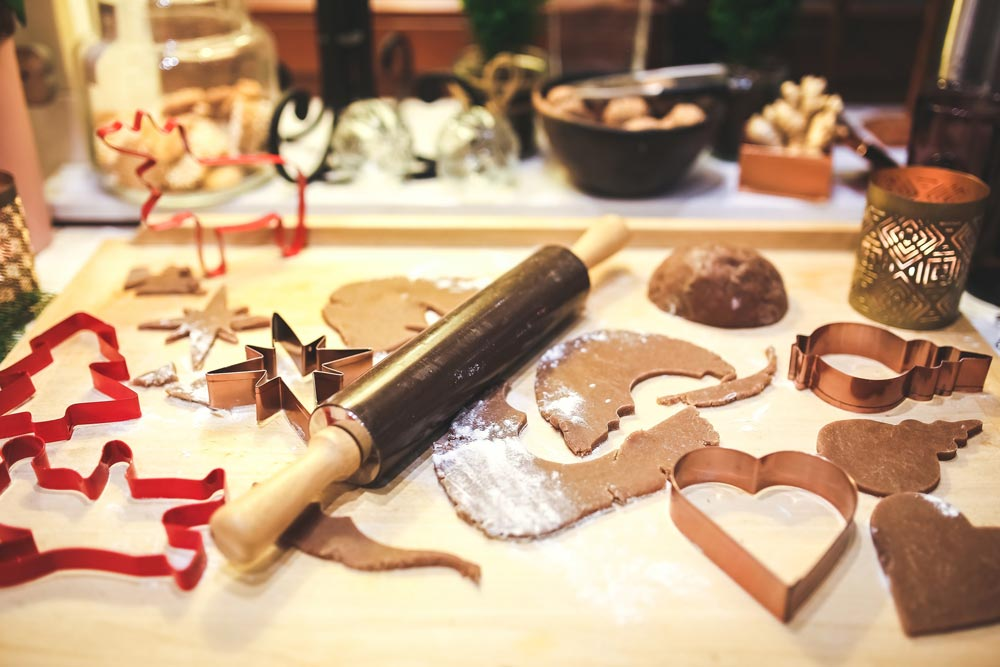 Baking in progress: Rolling pin, cookies, and cookie cutters