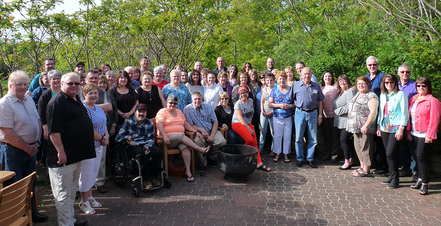Group photo of families on outdoor patio