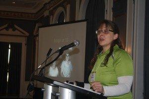 Woman standing at podium