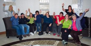 Group of people waving at camera