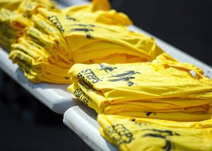 yellow T-shirts stacked on a table