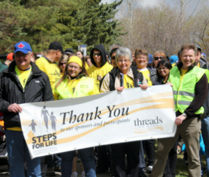 Steps for Life walkers with Thank You sign