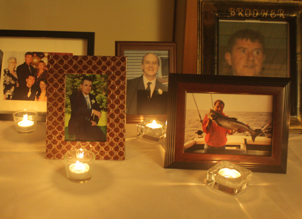 Photos of family members on candlelit table