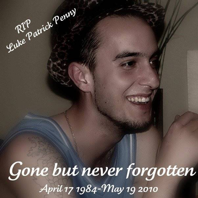 Photo of smiling young man in tank top. Reads: RIP Luke Patrick Penny Gone but never forgotten April 17 1984-May 19 2010