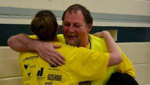 smiling man hugging a woman