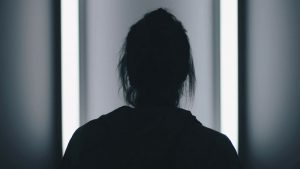 Silhouette of person's head and shoulders