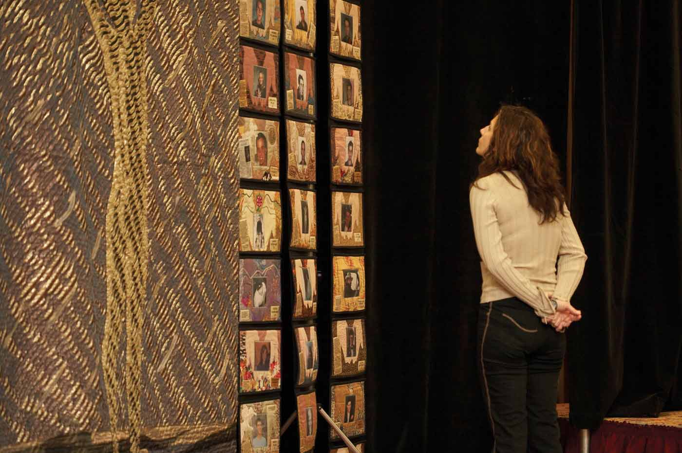 Woman stands in front of the LifeQuilt