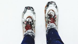 top view of winter boots in snow
