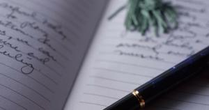 black pen on a handwritten journal page