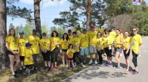 Team of participants wearing matching yellow Steps for Life t-shirts