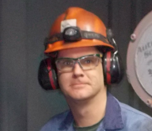 man in hardhat and ear protection
