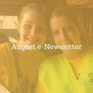 August 2018 e-Newsletter; text overlay on photo of two women smiling in yellow t-shirts