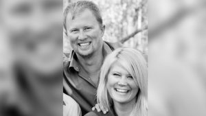 Man and woman smiling in black and white photo