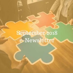September 2018 e-Newsletter; brightly coloured puzzle pieces on a table