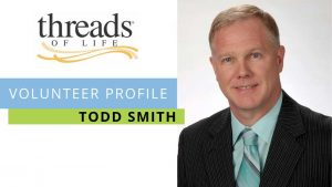 Threads of Life Volunteer Profile: Todd Smith - head shot of man with blonde hair in suit and tie