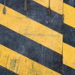 black and yellow stripes on a sign