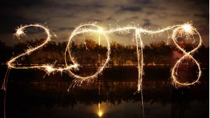 2018 written with sparklers against a lake at night