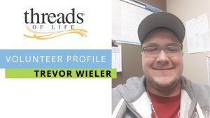 Volunteer Profile Trevor Wieler - selfie of smiling man in glasses and ball cap