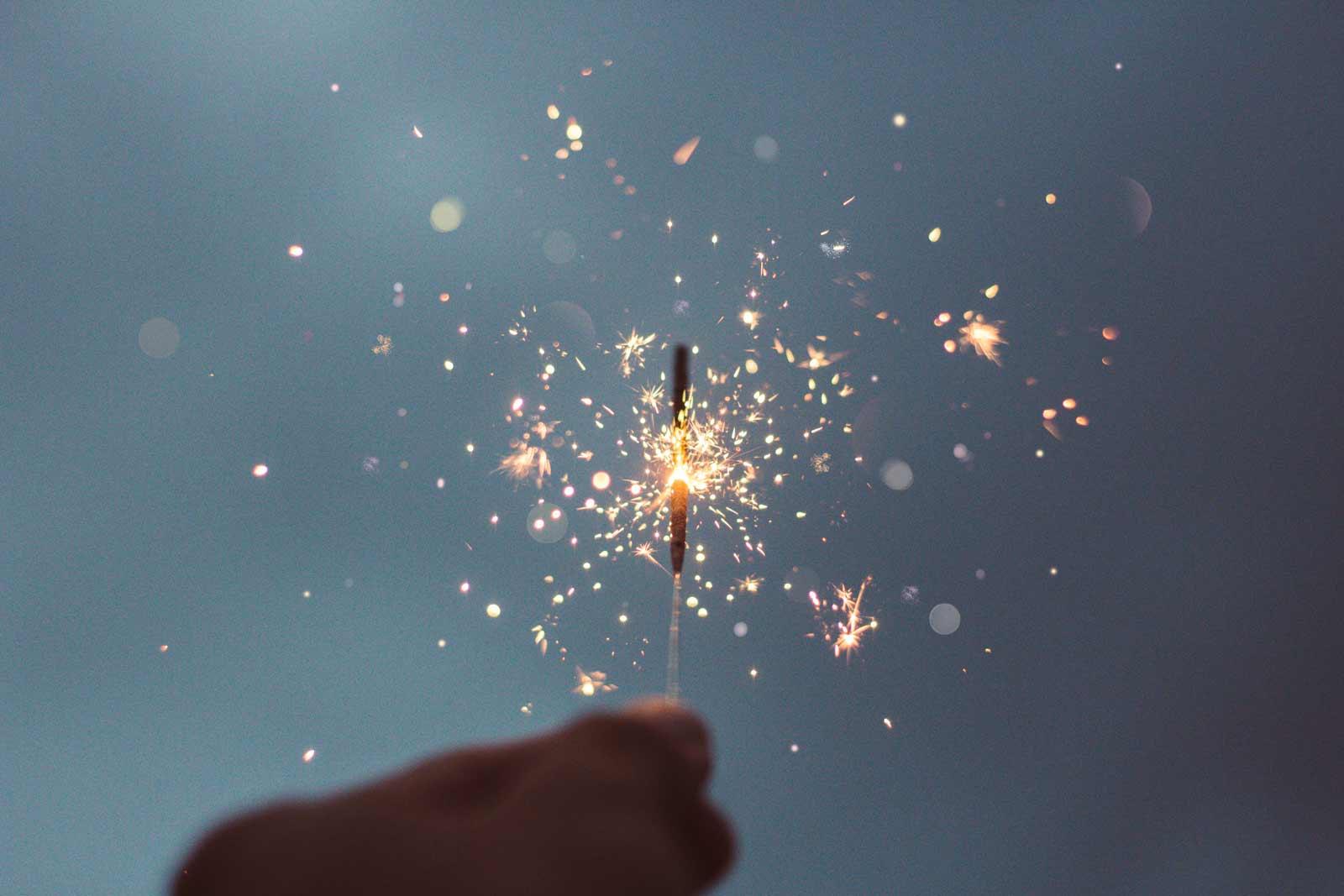 hand holding a lit sparkler