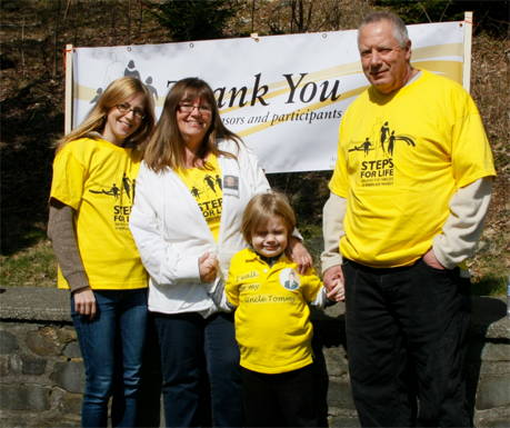 Family wearing yellow Steps for Life t-shirts