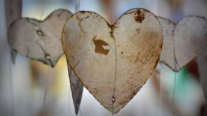 three paper-thin wood shavings shaped like hearts