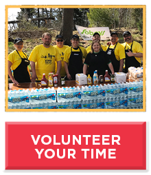 Group of people in yellow t-shirts, text reads volunteer your time.