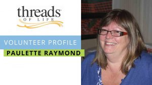 Volunteer Profile Paulette Raymond photo of woman with dark hair and glasses, smiling