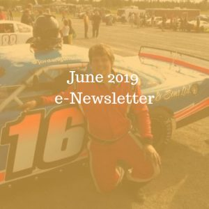 young man kneels in front of race car, text reads June 2019 e-Newsletter