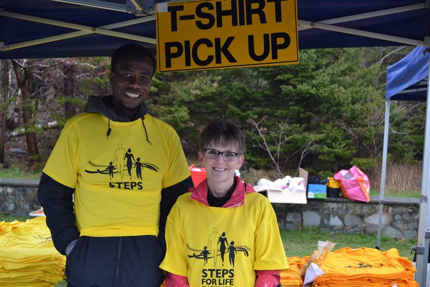 Steps for Life volunteers at registration table