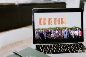 "An open laptop screen reads ""Join us online"""