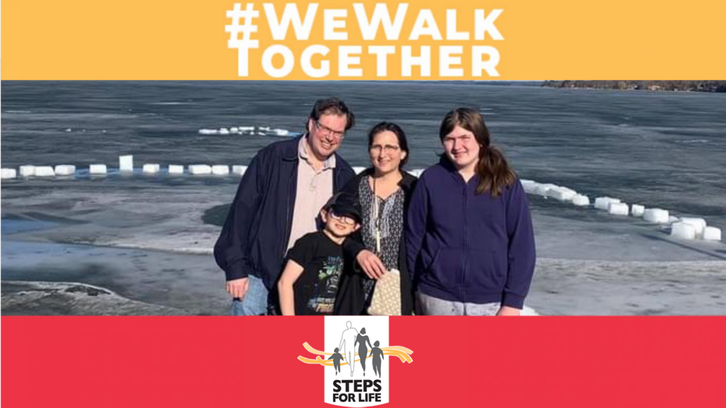 A family stands in front of an open body of water. Hashtag reading #WeWalkTogether  is above them and Steps for Life logo underneath.