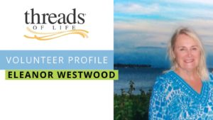 Photo of blonde woman smiling in front of a lake. Threads of Life logo displayed and reads Volunteer Profile Eleanor Westwood