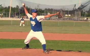 a pitcher winds up to throw a pitch